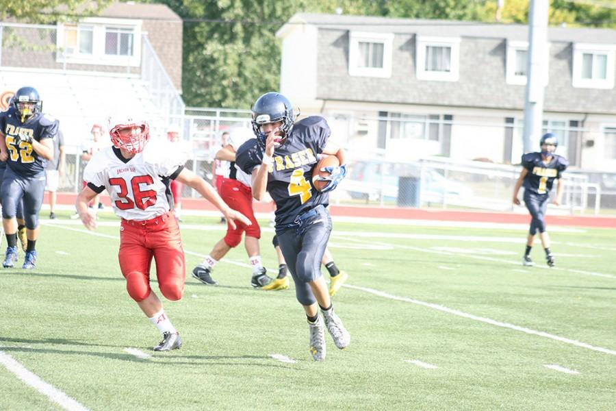 Running back Montez Cregeur carrying the ball past the Anchor Bay defenders.