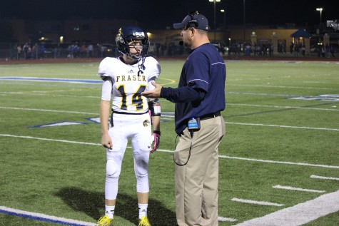 Coach Sklad and quarterback Ian Casey discussing a play during the 2nd quarter against L'Anse Creuse.