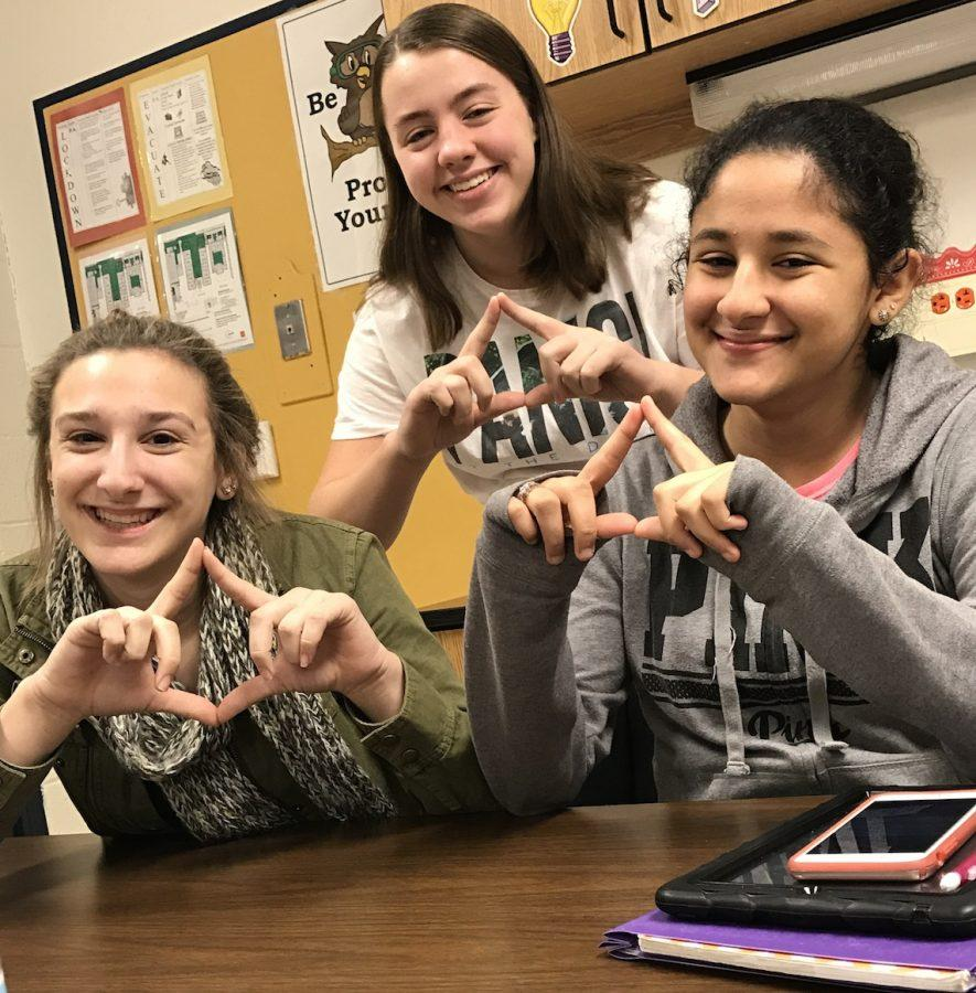 Courtney Lowe and Her Friends (Kylie Kremer and Yasmin Shkoukani) are having fun in their classroom.