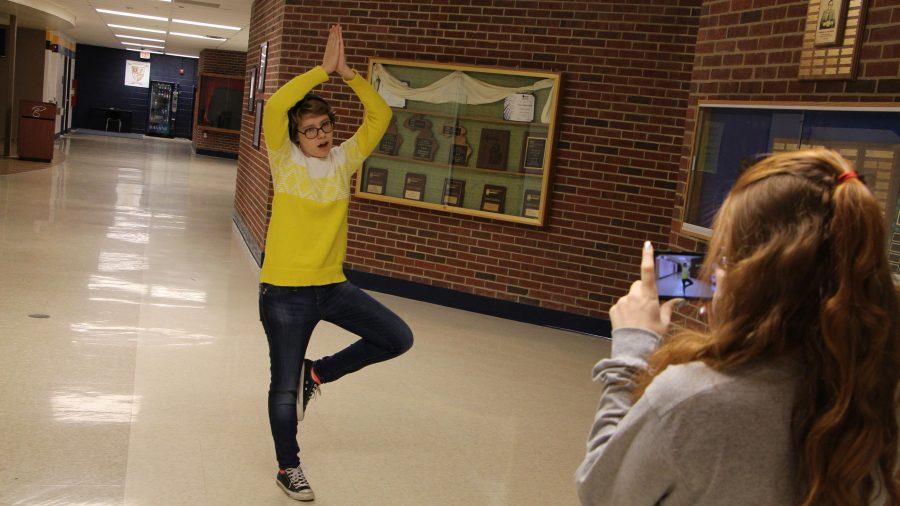 Senior Kiersten Tyler takes a Vine of Senior Sam Nork doing a yoga routine.