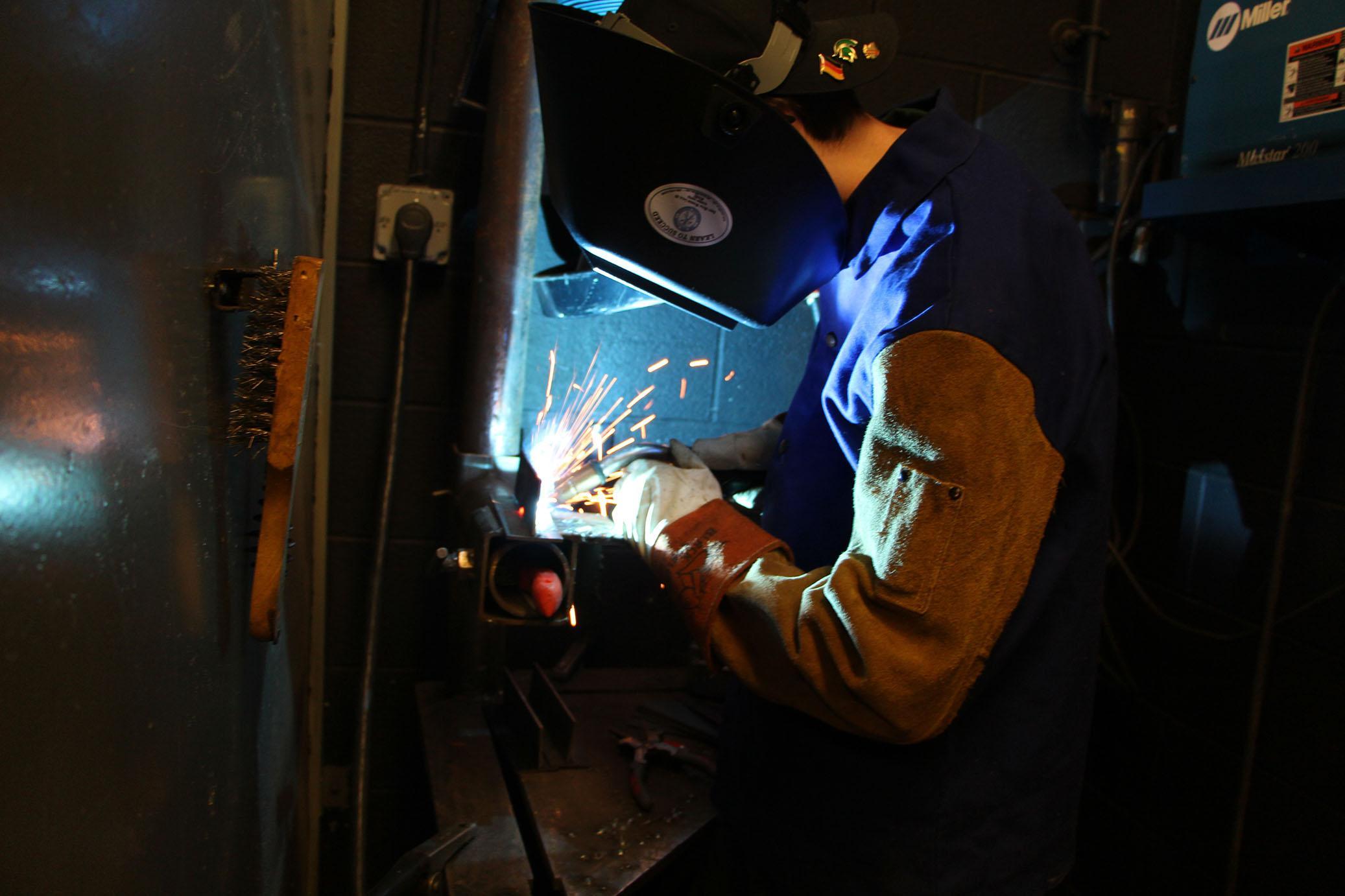 Senior Sean Smith practices a MIG weld.