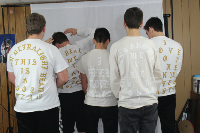 Anthony Zunno, Steven Kaczmarski, Marco Palimino, Justin Fasset, and Kyle Montgomery Showing off the back print of their Saint Pablo shirts by Kanye West
