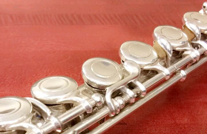 A student's flute sits in the band room, waiting to be played.