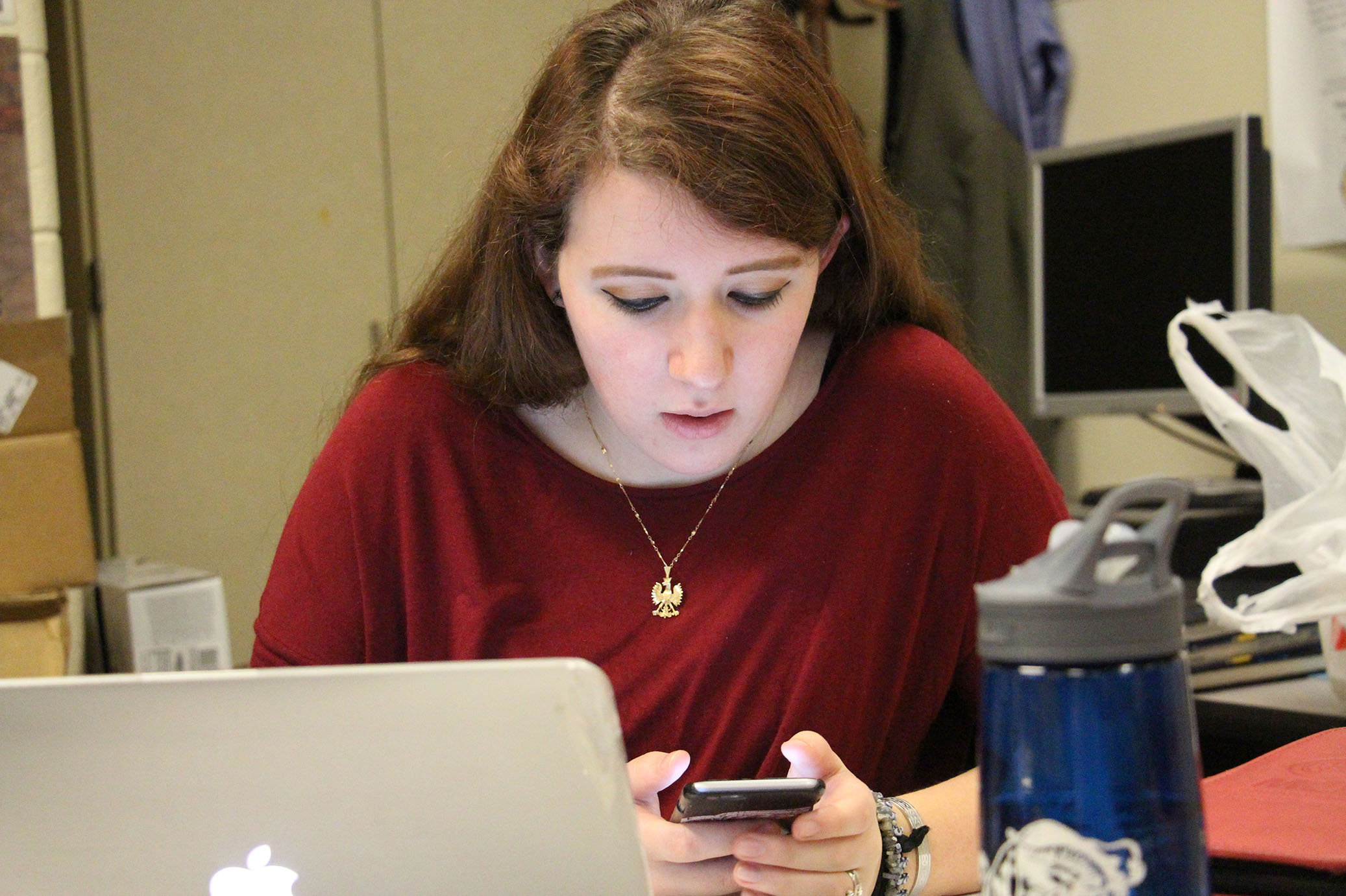 Senior Shelley Sawyer is on her phone, with a little bit of free time at the end of class Shelley sends a text. Shelley's phone provider is AT&T. Shelley sends about 100 text in a day.