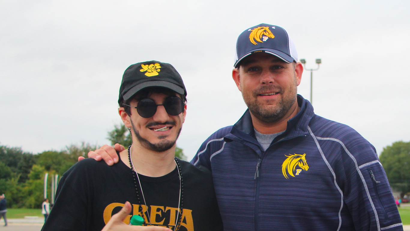Principal Ryan Sines with Peter, a senior, during homecoming.