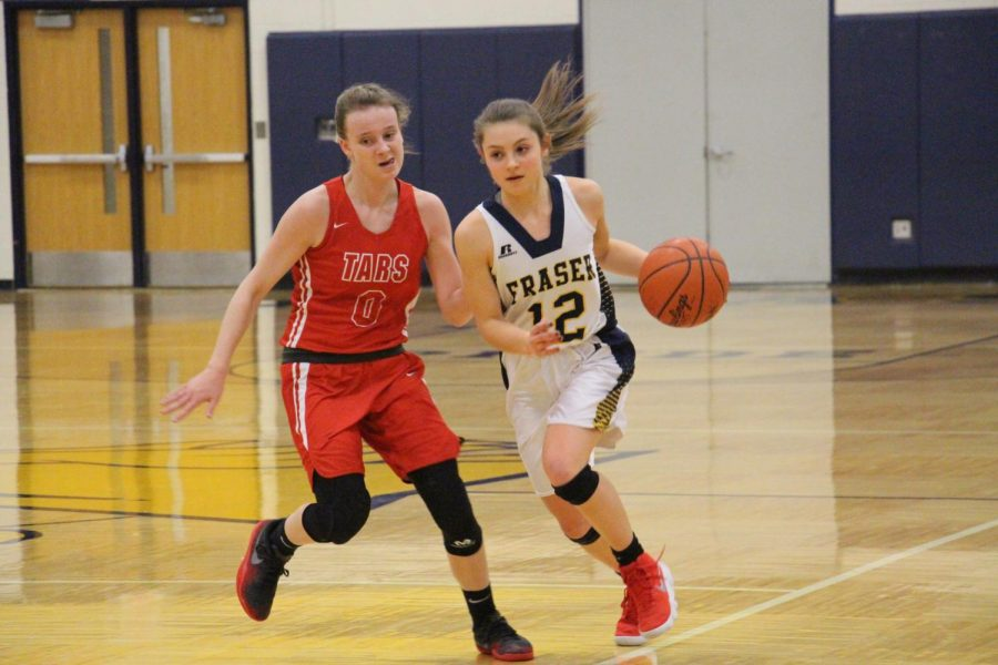 Senior guard Elise Vitale turns on the jets to speed past an Anchor Bay defender. the Lady Ramblers would go on to lose to the Tars 39-21.