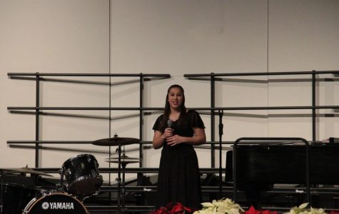 Sarah solo performance at the choirs' winer concert (Photo Taken By Annie Williams)