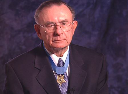 Marine Corps Pfc. Robert Simanek wears his Medal of Honor while discussing his actions in Korea. (Photo By: Library of Congress video still/Department of Defense.gov)
